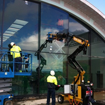 Hired glass lifter proves labour saver at cultural centre