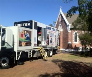 The fully self-contained Uretek operations rig sets up at St John's heritage listed church in Dalby, Queensland.