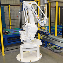 Fromm custom installs automatic strapping system for packaging line