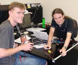 Blake Newman and David Kooymans working on FLECK nano. Image by Samuel Klistorner, CSIRO.